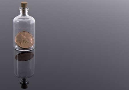 corked: One penny in corked bottle