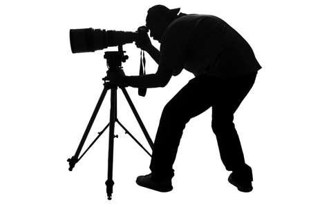 telephoto: Professional sports photographer silhouette  Stock Photo