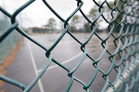 chain link fence: Background of a Baseball Dugout through a chain link fence  Stock Photo