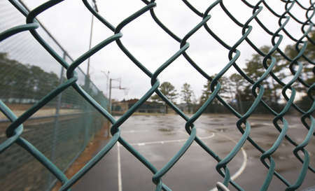 link up: Background of a Baseball Dugout through a chain link fence  Stock Photo