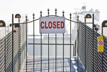 closed sign: Closed sign on ship yard gate