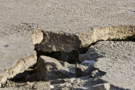 Cracked road concrete close up  photo
