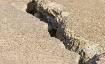 earthquake crack: Cracked road concrete close up  Stock Photo