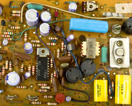 Vintage electronics background with resisters, capacitors,diodes   other components photo