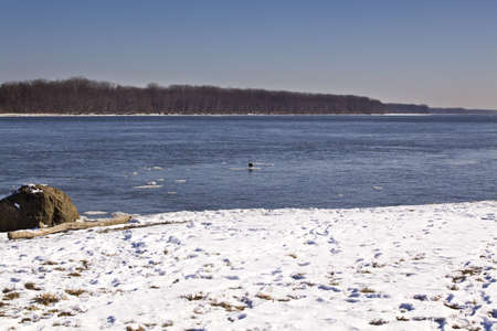 ice fishing: Missouri river on snowy day Stock Photo