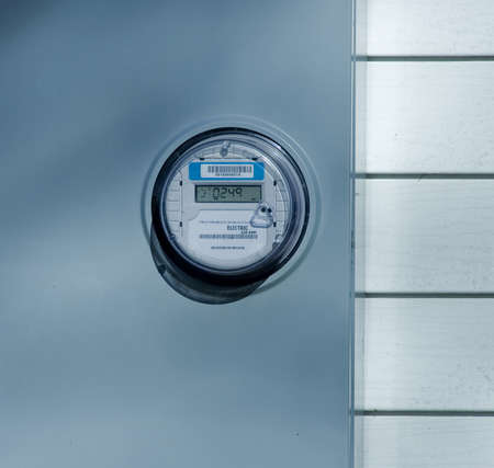 New electric meter on wall Imagens - 14909674