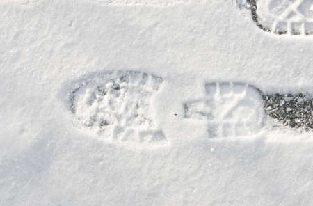 foot prints in fresh snow photo