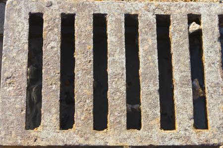 grate: Metal storm drain grate
