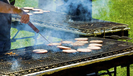 charbroiled: barbecuing hamburgers for party