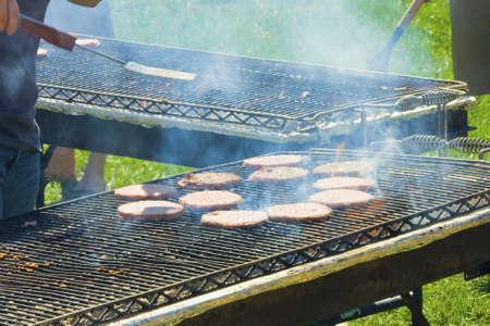 charbroiled: Enjoying a staycation preparing hamburgers Stock Photo