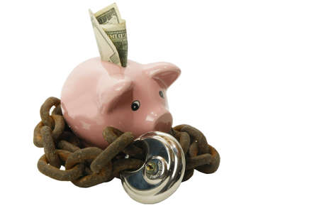 limits: Piggy bank secured with lock and chain