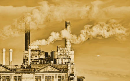 factory with smoke stack in sepia tone photo