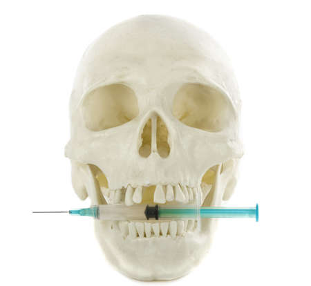 Syringe a skull concept on drugs isolated on white  Stock Photo - 14909363