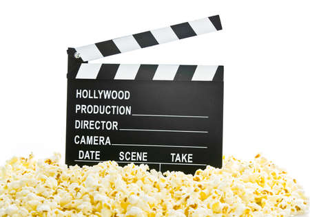 take action: Movie Clapper Board in popcorn isolated on white