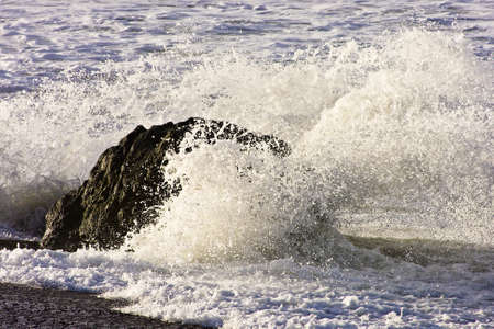 splash from waves on rock  photo
