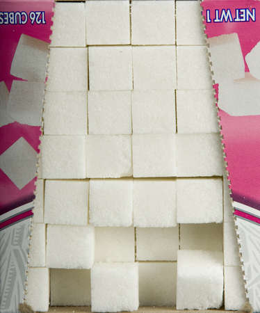 consumable: Sugar cubes in a box Stock Photo