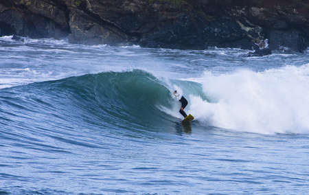 central california: early morning california wave with surfer