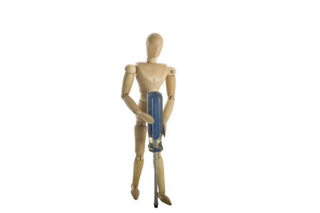 Wooden mannequin holding screwdriver  photo