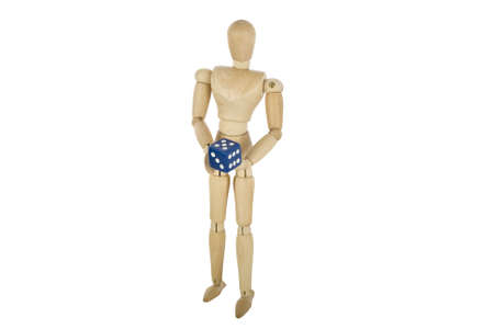 wooden mannequin holding dice photo