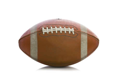 pigskin: Old american football isolated over a white background