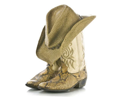 dirty cowboy boots and hat isolated Stock Photo - 15815273