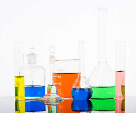 Laboratory glassware with reflections on white background Reklamní fotografie