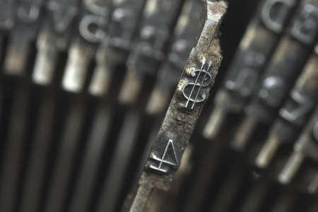 Old typewriter type with focus on dollar symbol  photo
