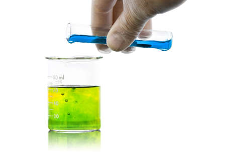test glass: hand pouring liquid chemicals into flask