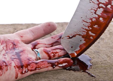 A knife smeared with blood and hand photo