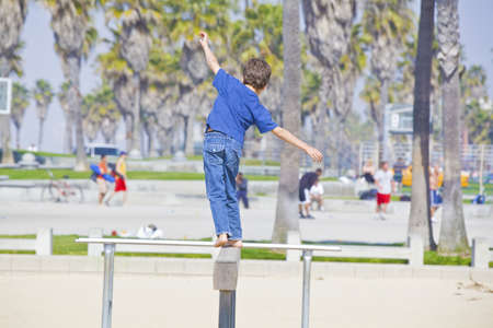 boy playing on balance beam