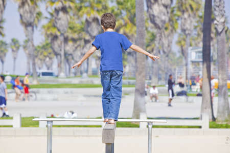 boy playing on balance beam photo