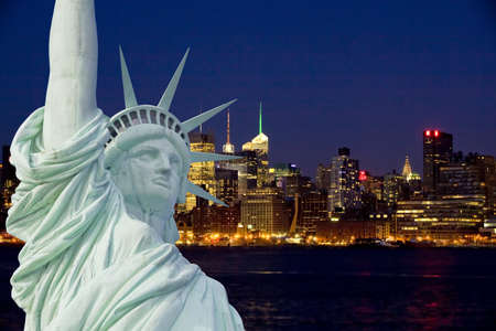 New York City Manhattan at night with statue of liberty photo