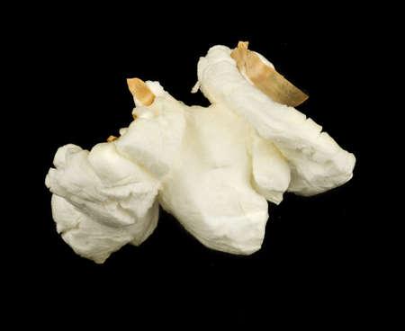 kernels: Popped popcorn isolated on black