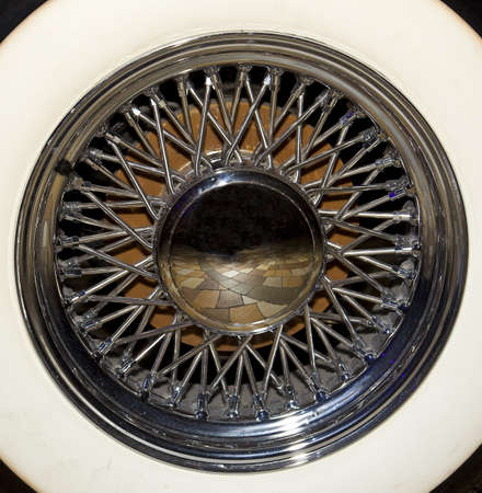 vintage whitewall tire and polished chrome of a vintage car wheel Stock Photo
