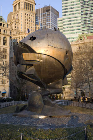 september 11: The Sphere was once at the foot of the twin towers of the World Trade center, but now are in Battery park near the Eternal Flame memorial for September 11 in New York , New York