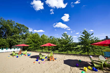 Red beach umbrellas and deck chairs on the white sand Stock fotó