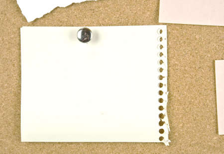 Cork bulletin board with notes   photo