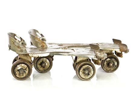 roller: Old clamp-on roller skates on white