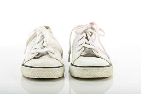 old kids sneakers on white background   photo