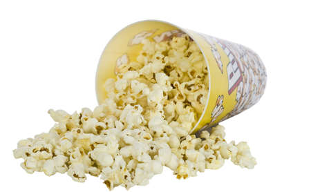 fresh pop corn: Popcorn in a container spilled