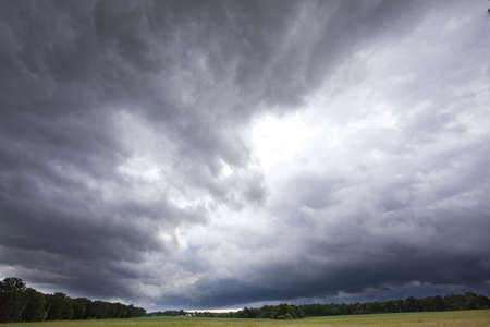 dark clouds: heavy storm clouds Stock Photo