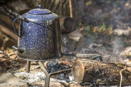 Morning coffee pot on the fire