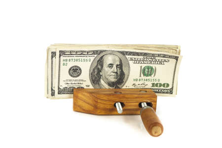 One hundred dollar bills squeezed tightly in a bench vice Stock Photo - 16006328