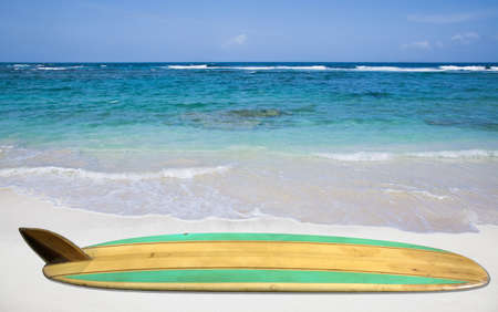 Vintage surfboard on the beach photo