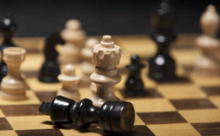 chess pieces on a chess board table photo