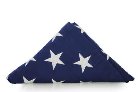 Folded US flag isolated on white