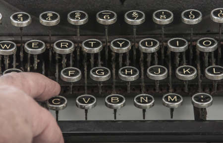 Vintage portable typewriter with fingers photo