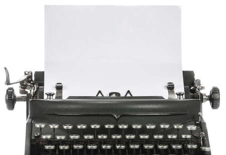 Vintage portable typewriter with paper on white