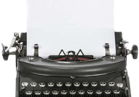 Vintage portable typewriter with paper on white   Stock Photo - 16861299