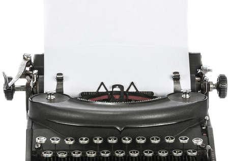 Vintage portable typewriter with paper on white Stock Photo - 16861299